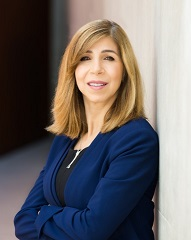 District Attorney Summer Stephan stands with arms folded in front of the Hall of Justice in San Diego, California.