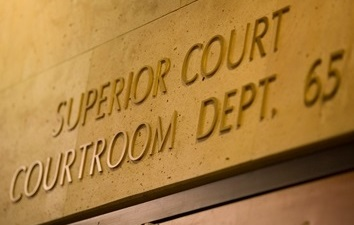 Image of a wall that says Superior Court Dept. 65